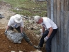 Eric (L) and Maurice building the retaining wall.